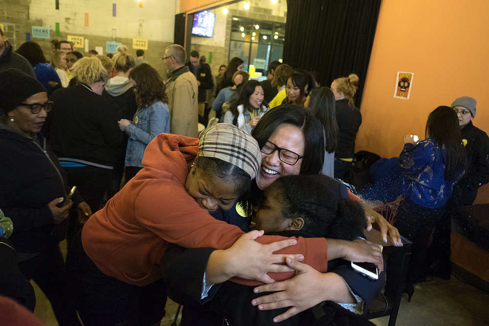 """On Nov. 6, Irene Fernando, center, was elected Hennepin County Commissioner for District 2. She and District 4-elect Angela Conley have made history by being the first two people of color to be elected to the board in its over 150 year history. Fernando rallied voters with a campaign that communicated greater advocacy, transparency and equity for the county through a clearly articulated policy agenda, her """"Commish Dish"""" YouTube videos, and the occasional Beyoncé reference."""