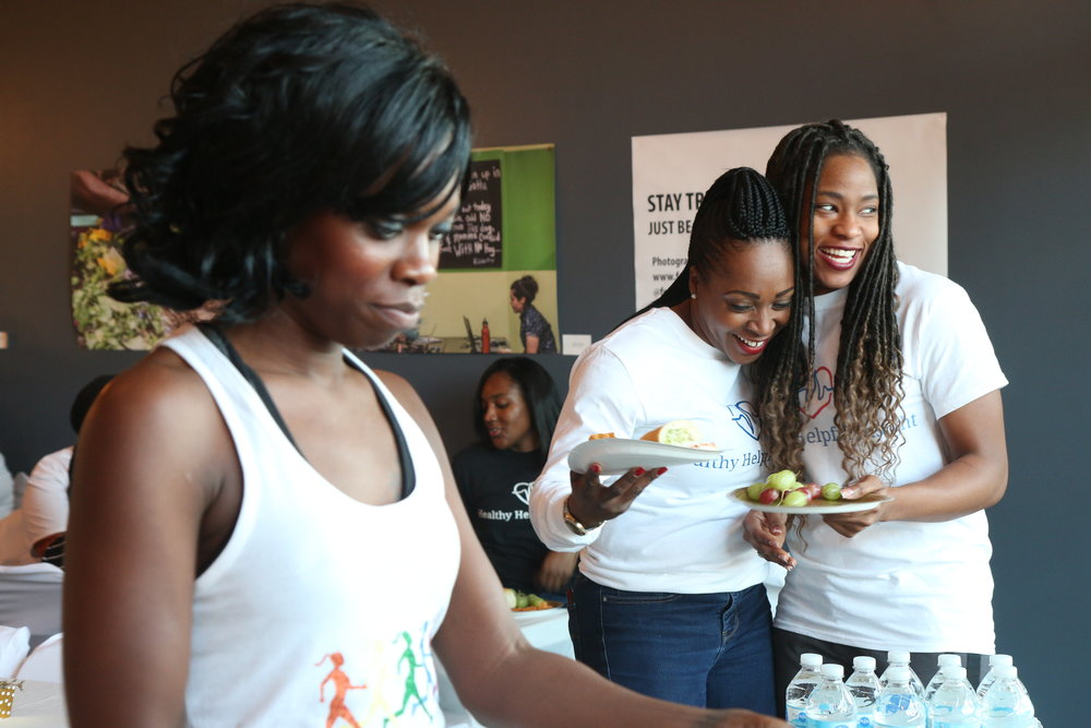 Latasha Lee (center) is a school nurse and the founder of Healthy Helpful Insights, a locally owned business which promotes holistic and community-centered health.  Photo by Farrington Llewellyn
