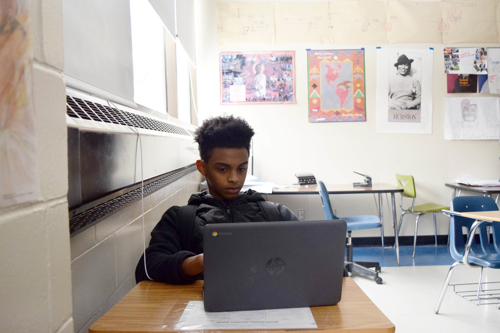 Junior Said Mohamed came to North High at the beginning of this school year. Here, he works on his history day project.  Photo by Frank Blount