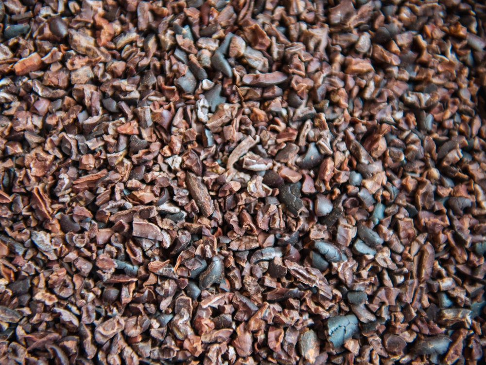 Winnowing - Once the beans are roasted, we crack them to break them into pieces, and, through a process called winnowing, separate out the delicious cocoa nibs from the outer husks that cover the whole beans.
