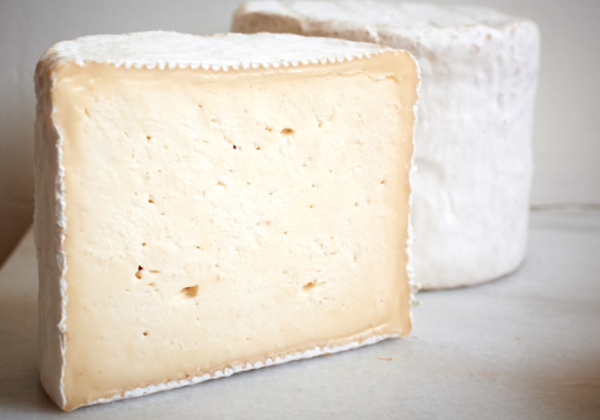 Eidolon  - a bright, grassy cheese that smells of freshly tilled earth and has a creamy layer topping its dense cake like center. It is a young, bloomy rind cheese made in a classic French style with delicate mold growth on the surface and a center that is rich and milky.