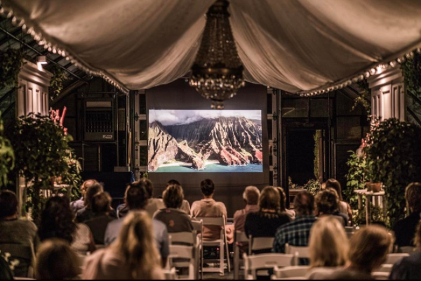 The film Island Earth being screened in the greenhouse at Pumpkin Pond Farm.  Photo courtesy of Dan Lemaitre.