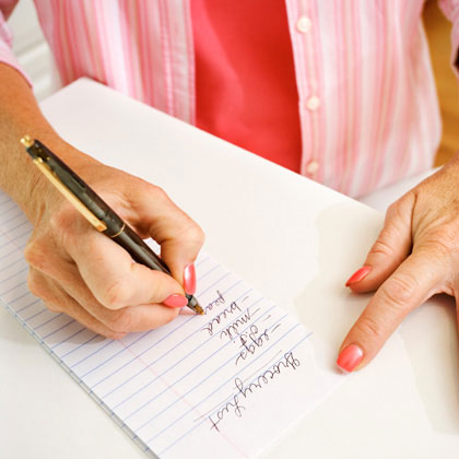 Woman writing grocery list (Source:  babble.com )