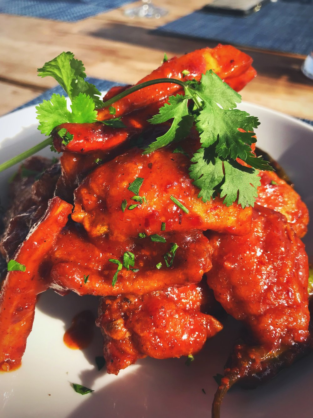 Crispy Fried Chicken Wings with a Red Chile Lime Glaze - Photo Credit: Mechelle Miller
