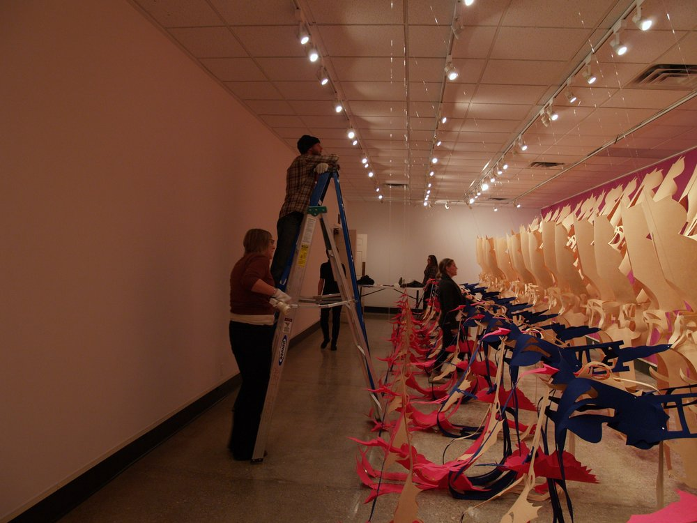 Gallery Director + students install Liz Miller's installation