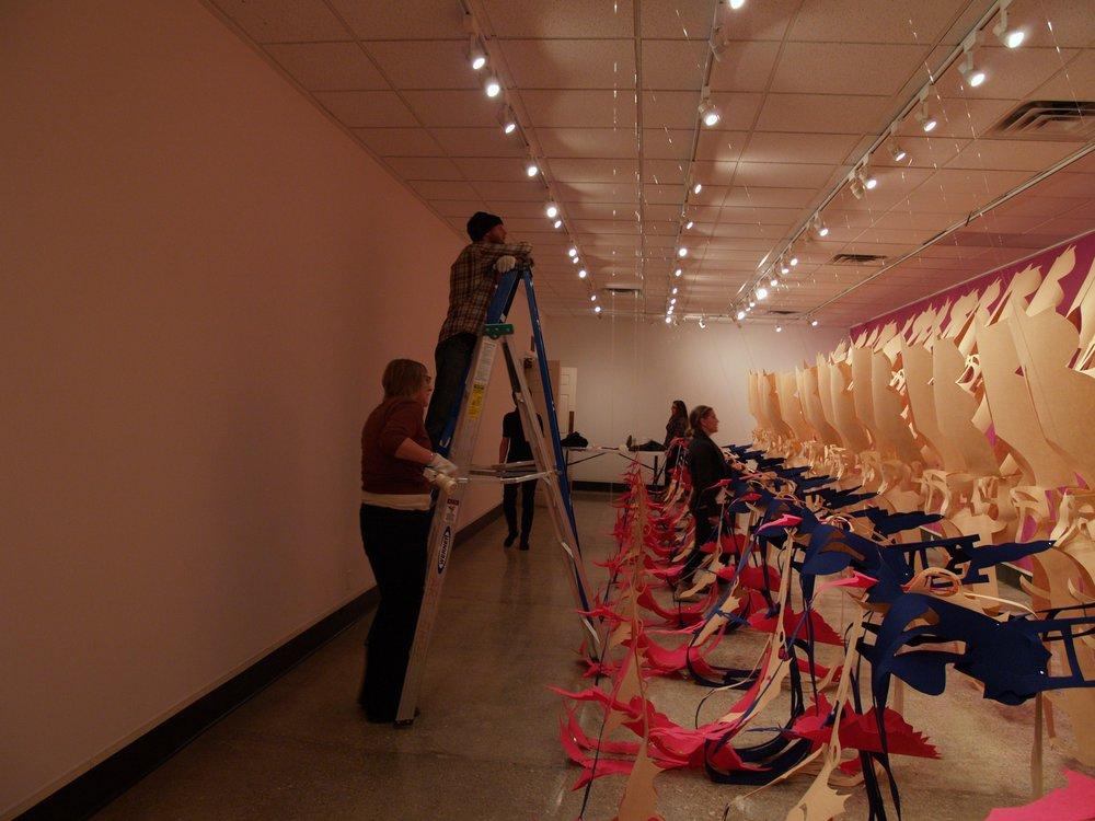 Gallery Director + students install Liz Miller's installation