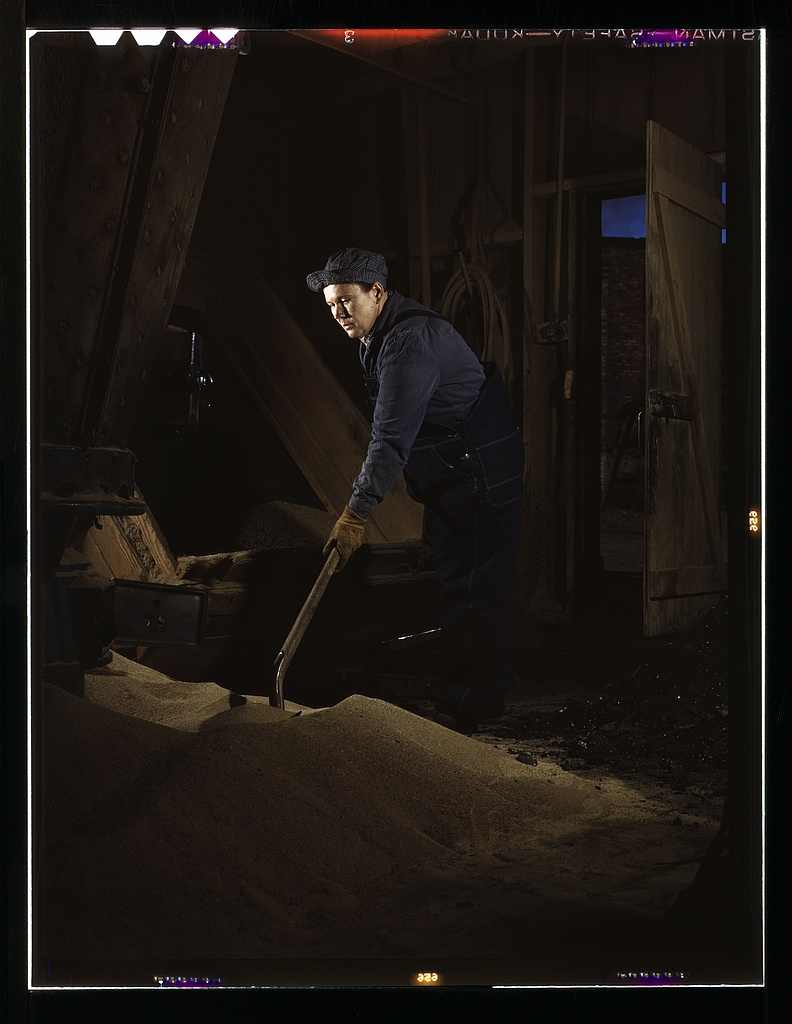 Chicago and North Western R.R., Thelma Cuvage, working in the sand house at the roundhouse, Clinton, Iowa. Her job is to see that sand is sifted and cleaned for use in the locomotives.   Source