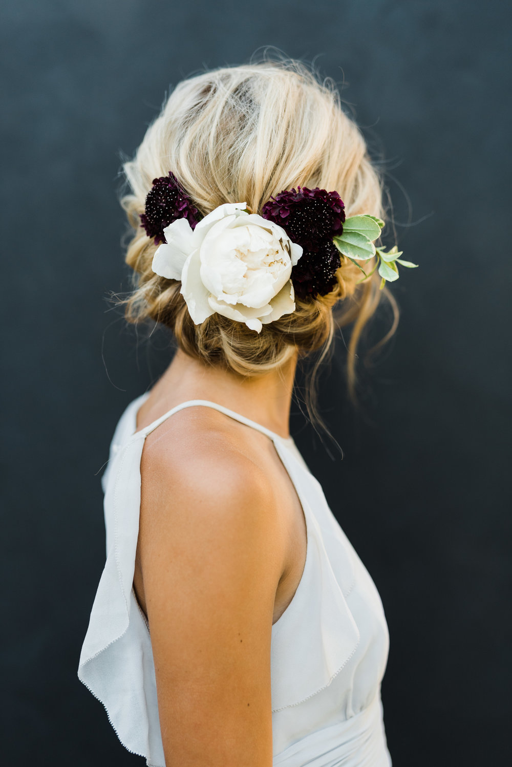 dark and moody floral hair style, Angela Nunnink photography, Angela Nunnink Hair and makeup, Mastin labs, Italy wedding, Scotland wedding, editorial