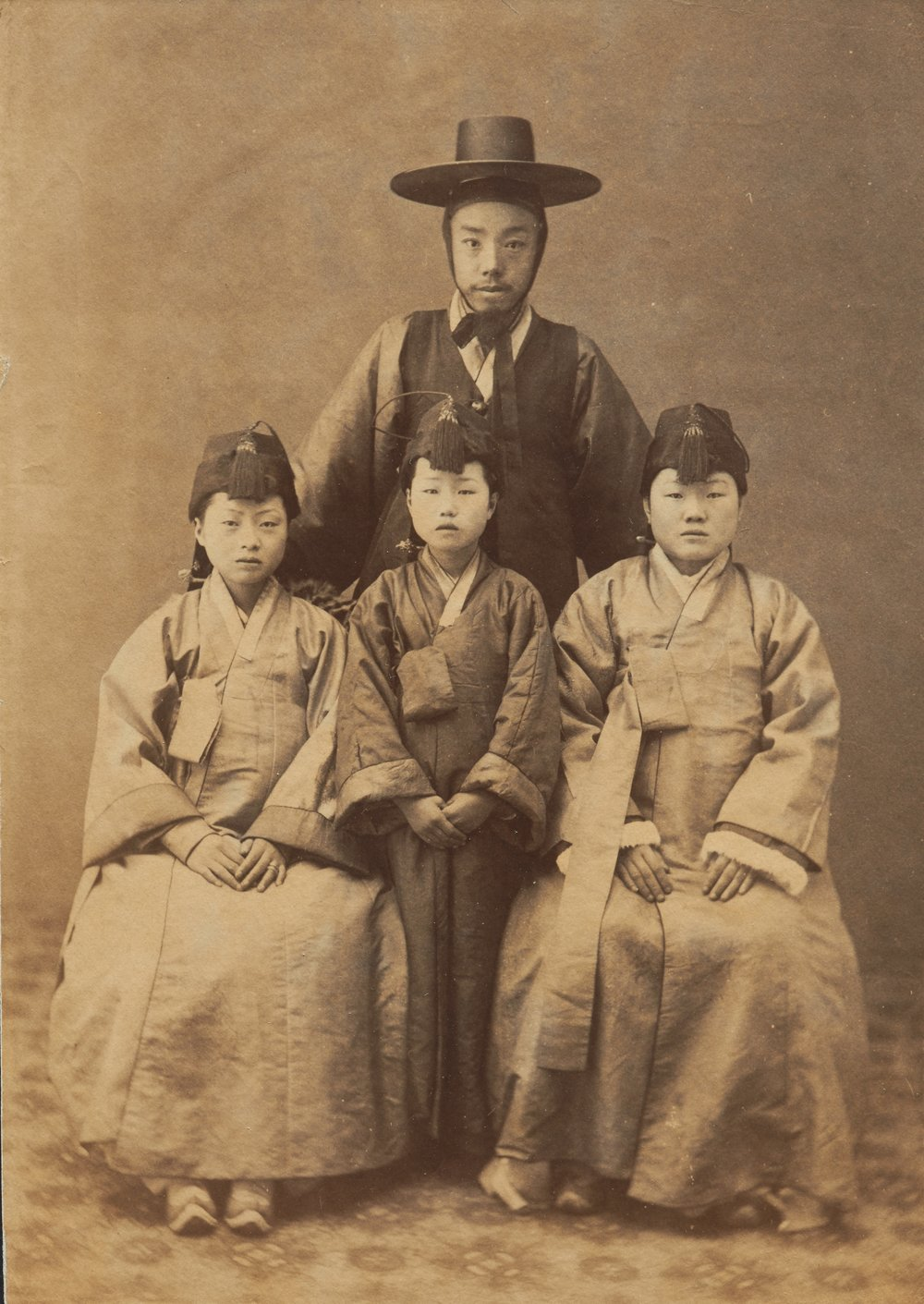 Korean Man and Three Girls, late 19th century, albumen print, Peabody Essex Museum