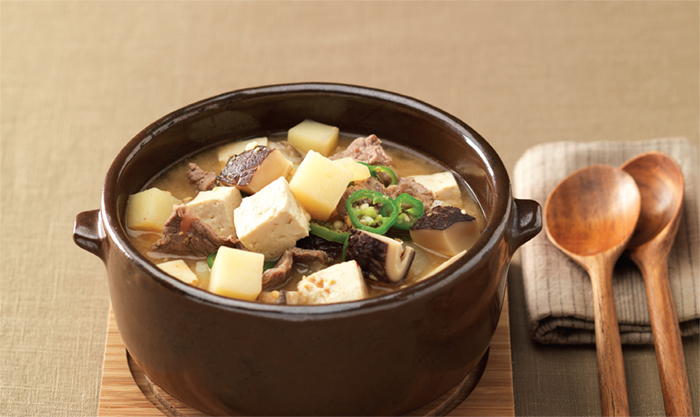Doenjang Jjigae (Soybean Paste Stew). This stew-like Korean dish is made by boiling an assortment of ingredients such as meat, clams, vegetables, mushrooms, chili, tofu, and soy paste.