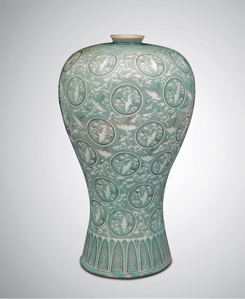Celadon Prunus Vase with Inlaid Cloud and Crane Design (Goryeo; 12th Century)  The jade green celadon ware represents the ceramics of the Goryeo period. The exquisite patterns on these objects were created by inlaying white and black clay into grooves etched on their surface. Inlaid designs such as this are recognized as a unique skill.