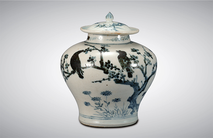 White Porcelain Jar with Plum, Bamboo, Bird Design (Joseon; 15th Century)  This vase made in the early Joseon Period displays a uniquely Korean atmosphere in its refined portrayal of bamboo, plum, and birds.