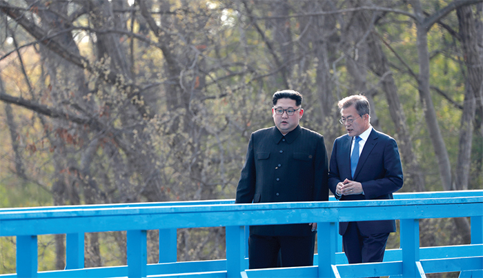 President Moon Jae-in and Chairman Kim Jong Un walking along a footbridge at the border village of Panmunjeom