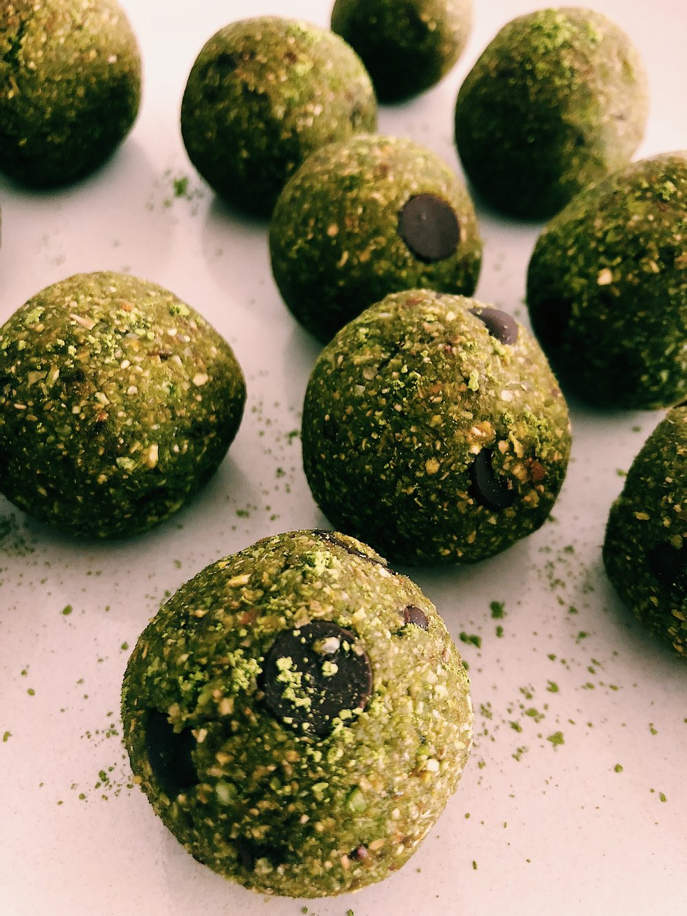 MATCHA CHOCOLATE CHIP BALLS - INGREDIENTS1 1/2 tb matcha, plus extra for sprinkling on top2/3 cup fine almond meal (I used Bob's Red Mill because it's nice and fine)1 cup gluten free rolled oats1/2 tsp vanilla extract1/2 cup unsweetened shredded coconut1/2 cup dairy free chocolate chips (I used Enjoy Life Foods)10 medjool dates (or 1 cup), pitted, and soaked in hot water for 15 minutes until soft1 scoop collagen peptides (optional)