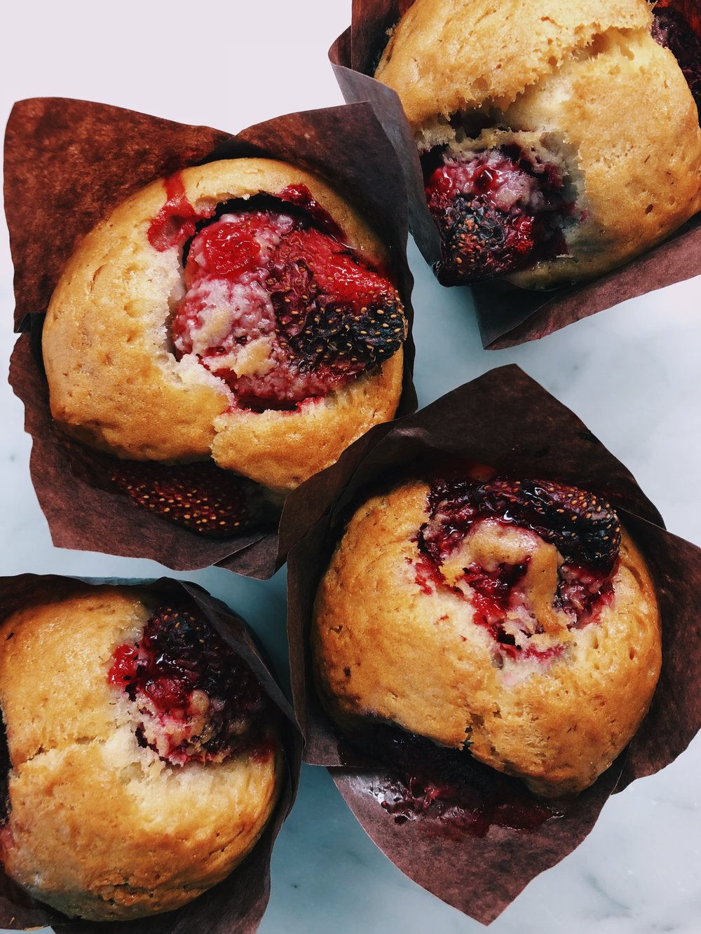 STRAWBERRY BANANA MUFFINS - INGREDIENTS3 very ripe bananas1 3/4 cups gluten free flour1 tsp baking soda1 tsp cinnamon1 tsp vanilla extract1/2 tsp salt1 cup coconut sugar1/2 cup melted coconut oil (or avocado oil)2 large eggs1 3/4 cups roughly chopped organic strawberries