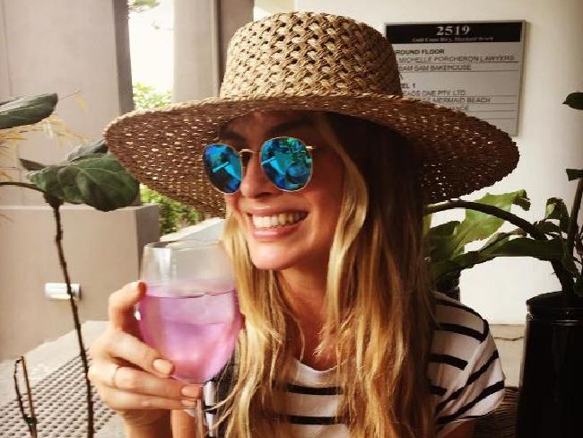 Margot Robbie enjoying a pink gin in the lead up to her Queensland marriage.