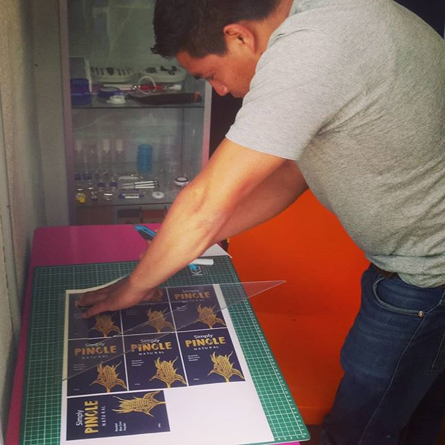 Kickstarter pledgers. We're coming soon with your gifts! 🤗 Here is Leo, our partner, cutting up our packaging stickers. Thank you 🙏 #mexico #magic #startup #business #food #health #challenge #farming #supporter #kickstarter #launch #foodforfoodies