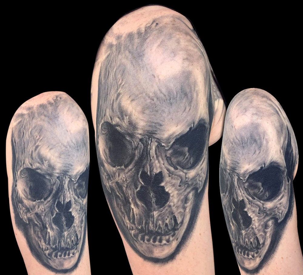 Black and Grey Shoulder Cap Skull Tattoo, (healed)  This skull is the top piece of a sleeve in progress, consisting entirely of different variations of human skulls.