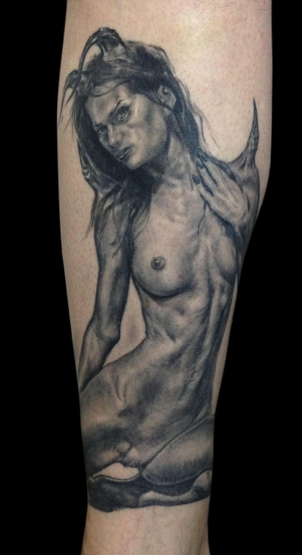 Black and Grey Nude Female Demon Tattoo,  (healed) on calf