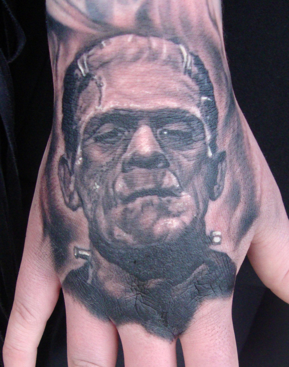Black and Grey Frankenstein's Monster Portrait Tattoo on Trine Grimm,  (fresh) hand, Inferno Metal Fest, Norway