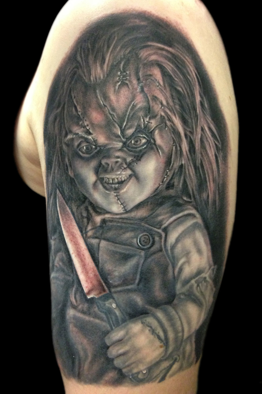 Black and Grey Chucky Child's Play Portrait Tattoo, (part fresh, part healed)