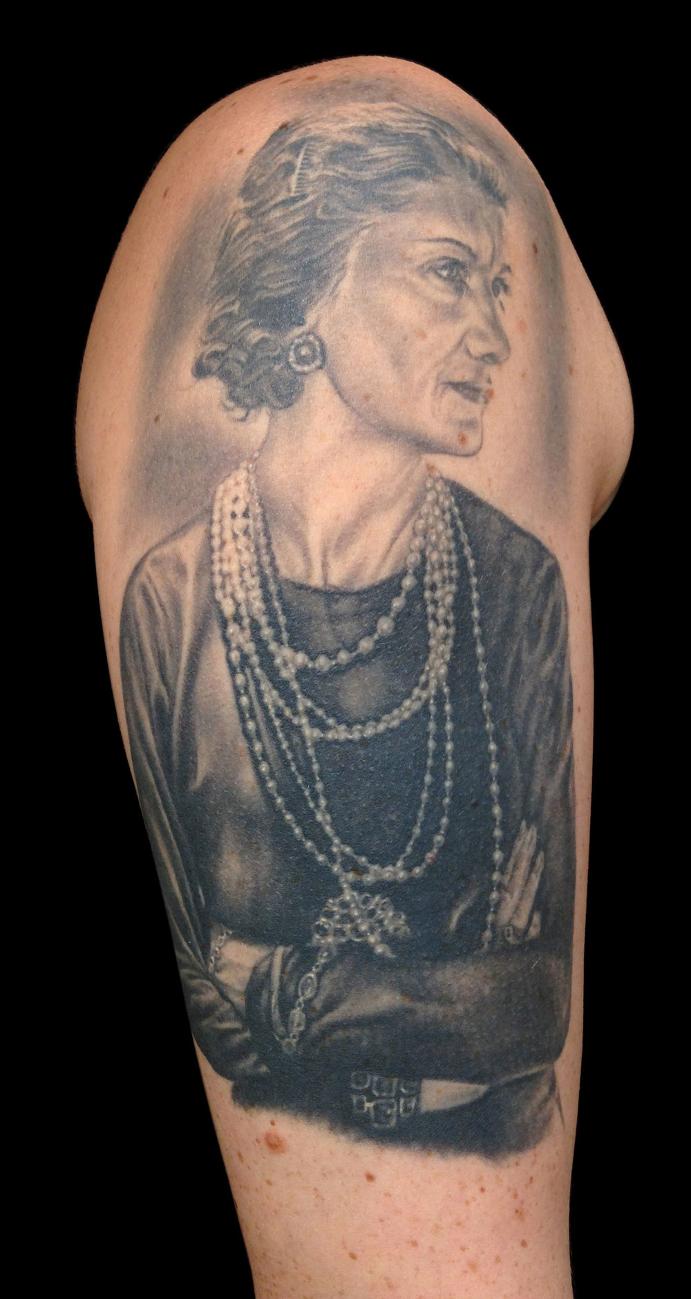 Black and Grey Coco Chanel Portrait Tattoo, (healed)