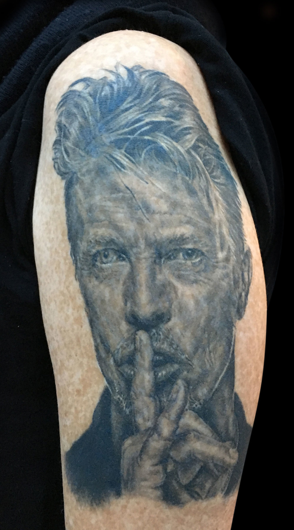 Black and Grey David Bowie Portrait Tattoo, (healed)
