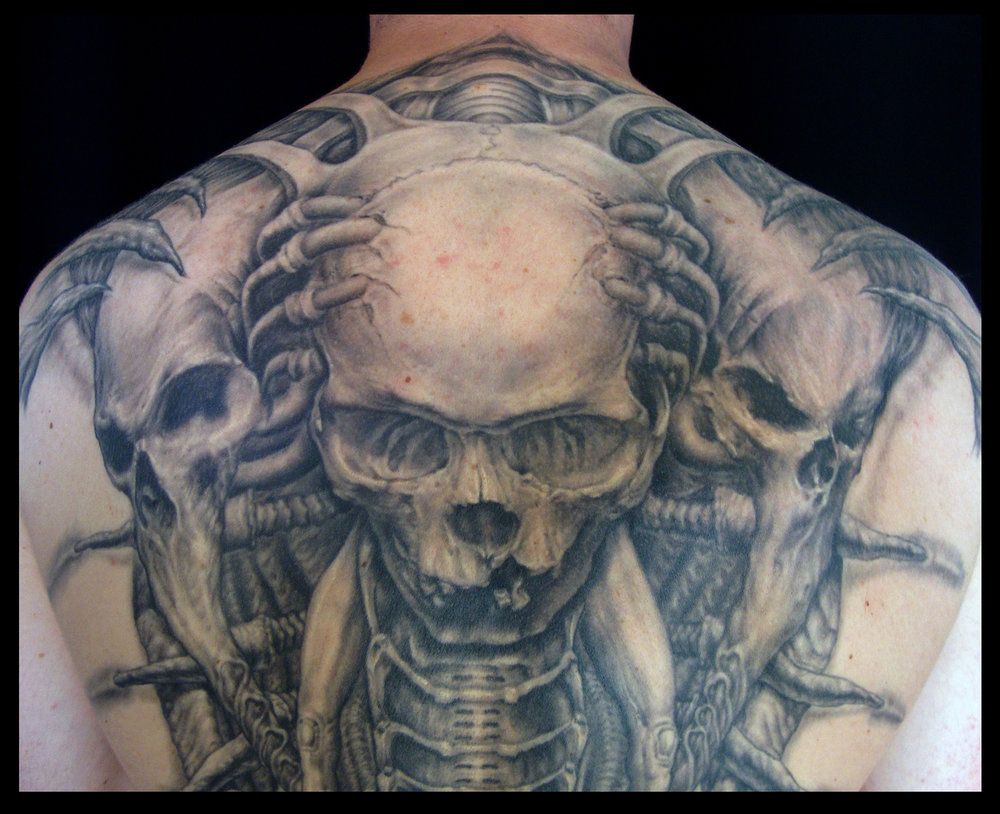 Black and Grey Biomech Skull Back Piece Tattoo, (healed) detail zoom