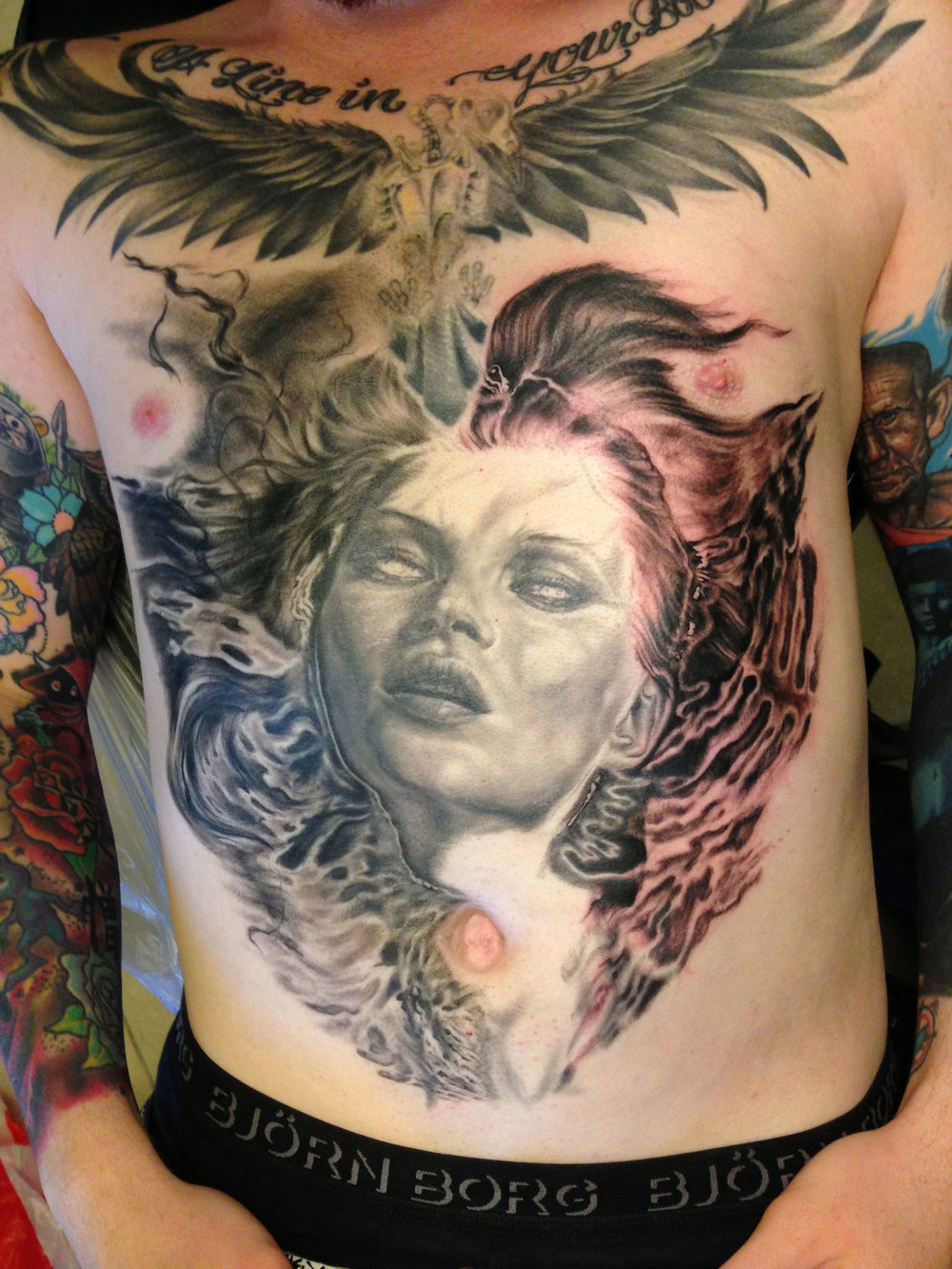 Black and Grey Drowned-Eyed Beauty Emerging from Water, torso tattoo in progress  (Bird and script on top are not mine, tattooed from another artist)