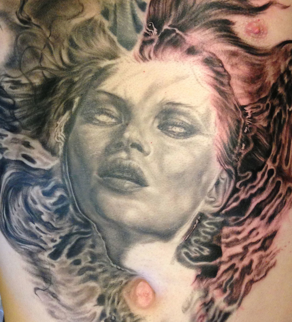 Black and Grey Drowned-Eyed Beauty Emerging from Water, torso tattoo in progress  detail zoom of lips, hair etc.