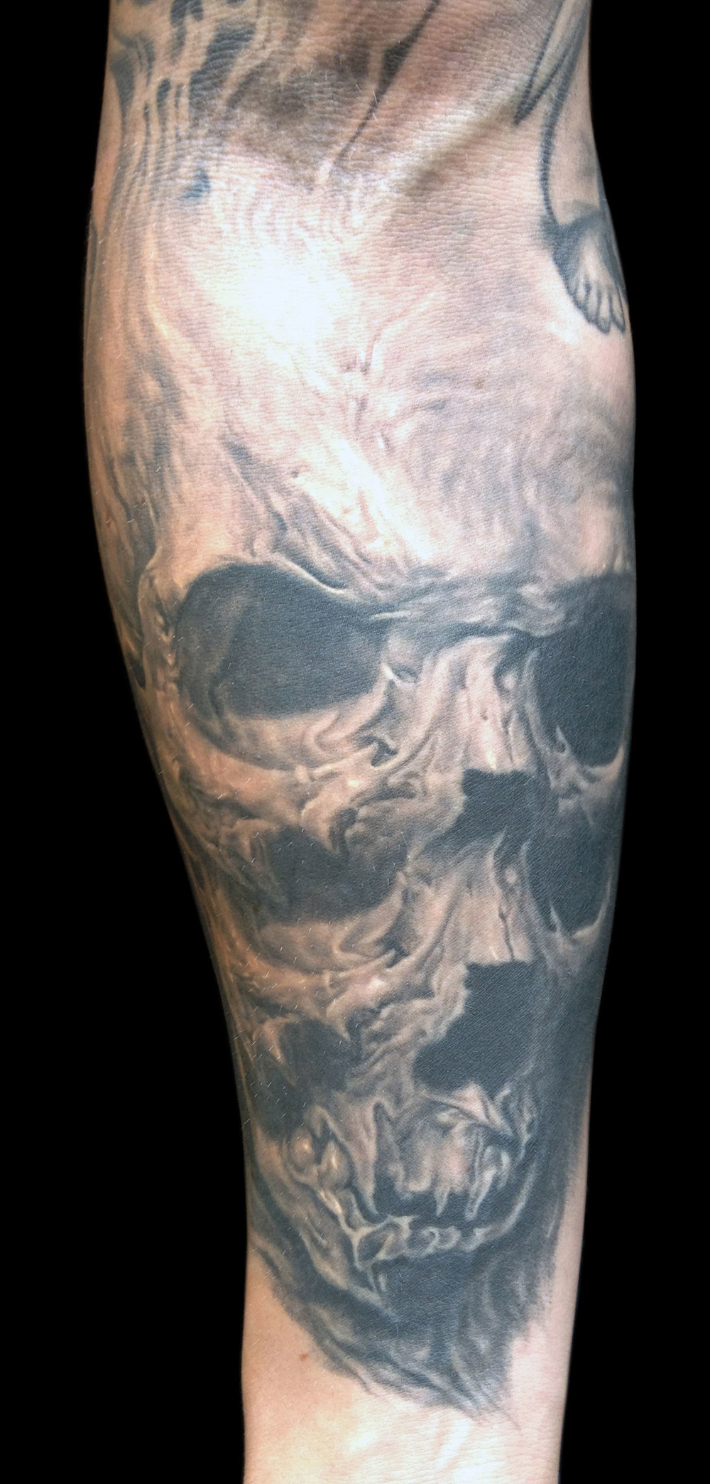 Black and Grey Surreal Horror Skull Tattoo, (healed)