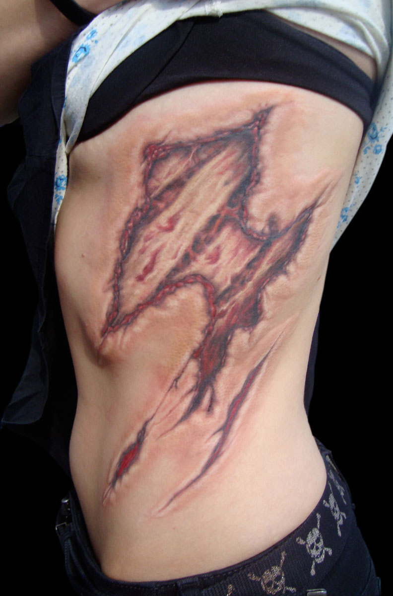 Color Anatomical Gore Tattoo on Ribs, (healed)