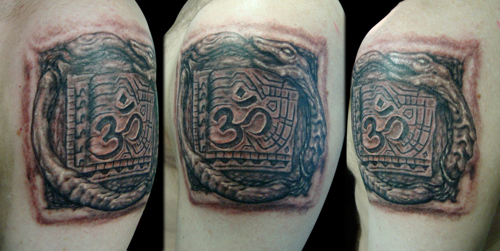 Black and Grey Ouroboros Tattoo Interwoven Through Flesh with Om Circuit Board, (fresh)  2008?