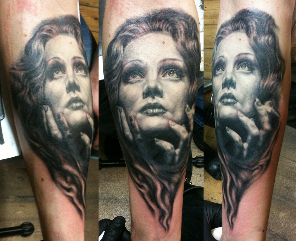 Black and Grey Expressive Woman's Face with Hands Tattoo, (part fresh, part healed)
