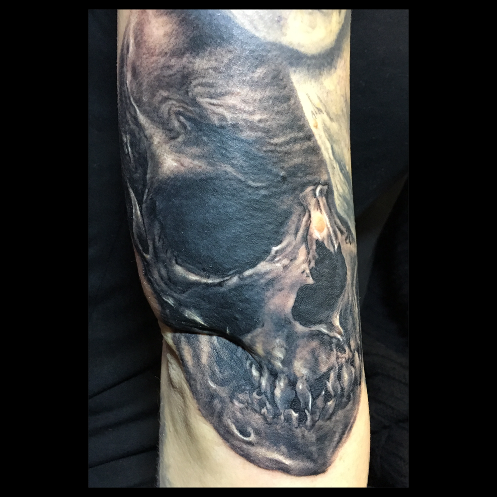 Black and Grey Skull Tattoo, placed for 3D sculptural effect.  Tattooed at the International London Tattoo Convention (fresh)