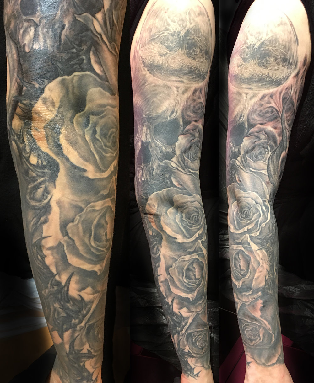 Black and Grey Sleeve Tattoo with Roses, Thorns, Skulls, …Black Widow, etc.  Almost finished with this one!
