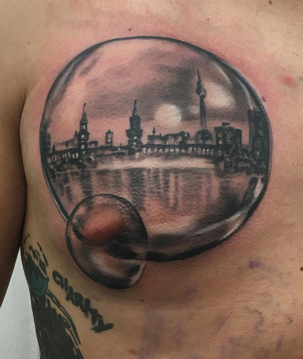 berlin skyline in a bubble realistic black and grey truevagabondtattoo berlin.jpg