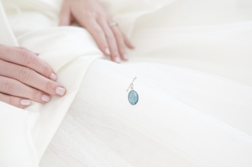 "My most favorite, ""something blue"" pinned to the inside of my dress."