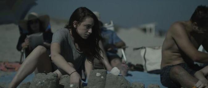Simone Policano, Drigan Lee, and Patricia Randell on location on a (very windy) beach.