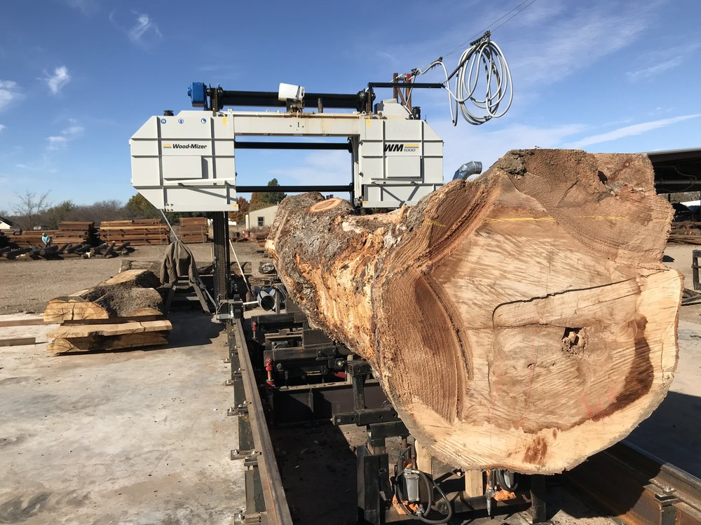 """WM 1000   67"""" diameter, 54' long capacity. The thin kerf blade will save your valuable logs from the waste that is incurred when you slab with a chainsaw. We are able to cut live edge slabs up to 67"""" wide. -----------------------$250/hr"""
