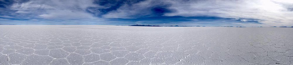 Even panoramic photos don't do the vastness and endless salt plains justice. Here, the sky and the flat seem to coincide at the edge of the world, and there is nothing here, except salt.