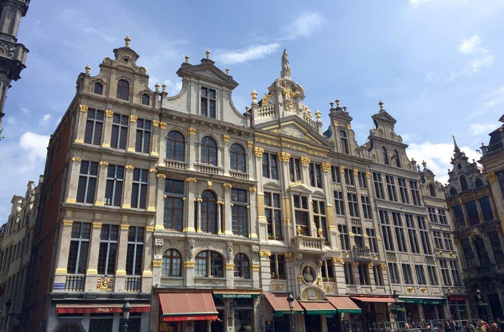 The intricate details carved onto the guildhalls that encompass several sides of the square are ornate in their beauty.