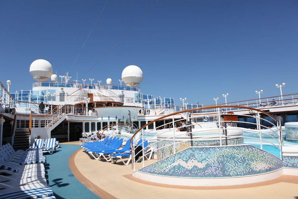 The pool area onboard. The large circular globes on the top of the ship are radars, integral to the geolocation and operation of the ship.