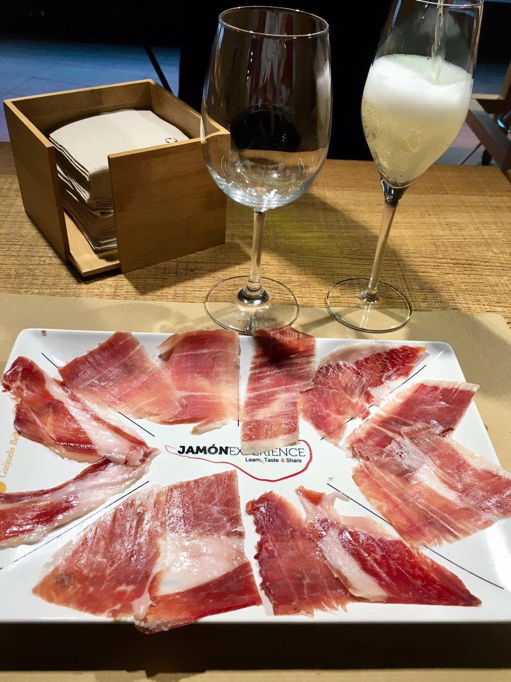 The four types of ham at the bottom are bellota, from acorn-fed pigs. The top left is serrano, and the right normal Ibérico. Notice how the bellota hams have glossier texture compared with the other two.