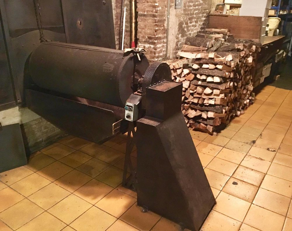 The roasting oven, using chopped wood.
