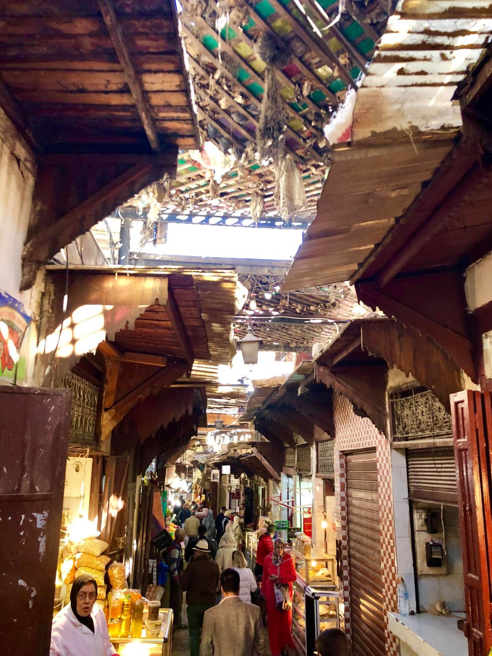 This alleyway seems to be one of Laundromats, whom wash and dry batches of clothing on the streets and inside the courtyards.