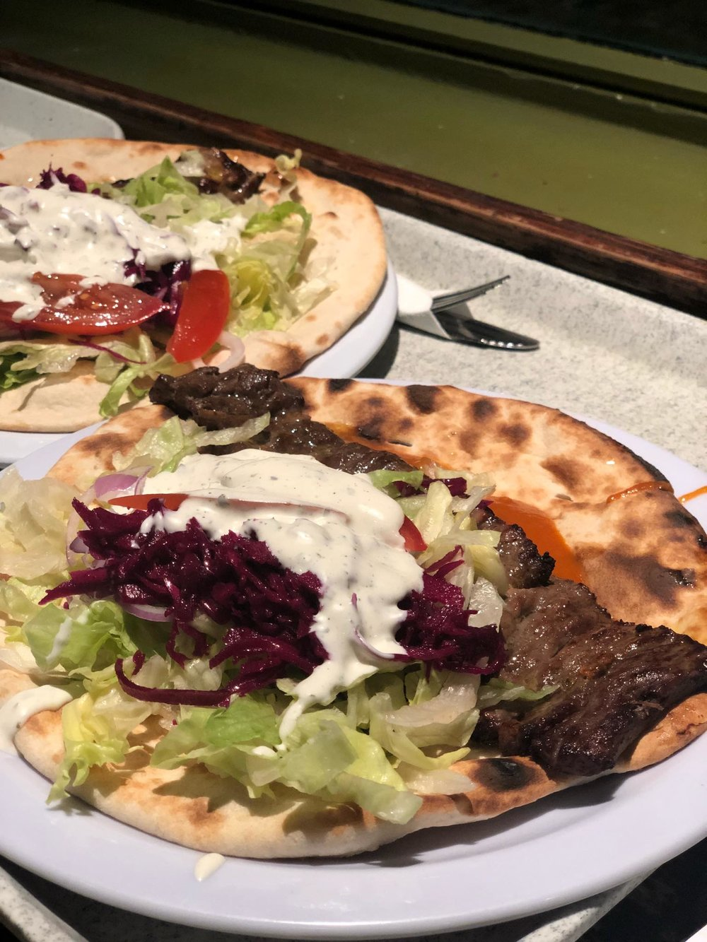 - Left, one of Zaytoon's specialty items, along with the grilled chicken kebabs: Barg - fillet of beef marinated with saffron and special spices.