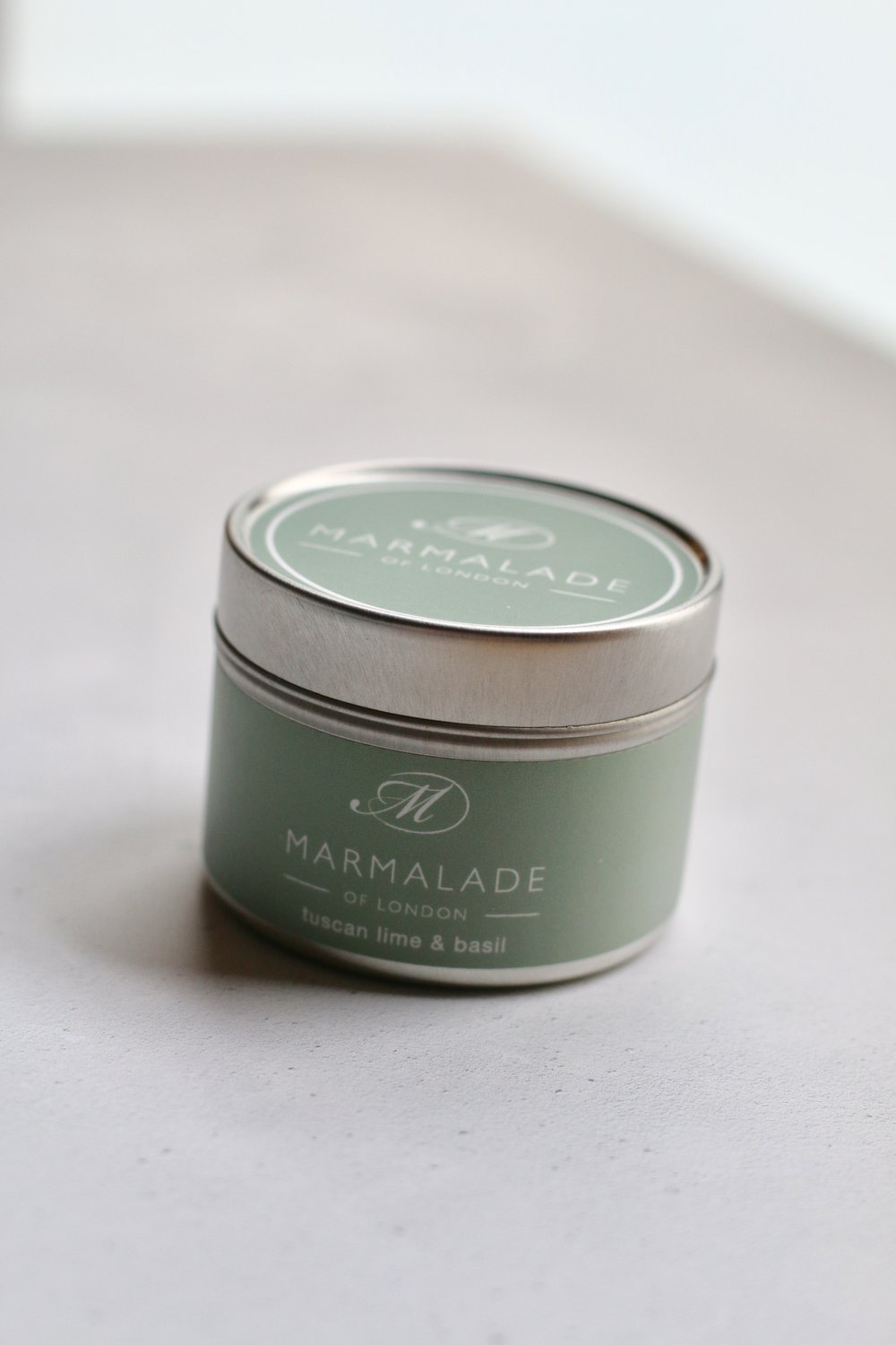 Marmalade of LondonCandles Review - HAND POURED AFFORDABLE LUXURYMarmalade of London is a British brand that creates a little indulgent luxury for every home. They have a passion for fragrance and design which is seen in their contemporary packaging and design.All of their products are lovingly made in Britain and their candles are 100% soy wax with cotton wicks and essential oils.From the moment you lift the lid on one of these wonderful candles, the room is filled with distinct scents, that can cut through even the most stuffiest of atmospheres. Marmalade's Tuscan Lime and Basil scent has some seriously sharp citrus tones, perfect for any overriding any kitchen smells. But with the earthy undertones of Basil, this scent is mellow enough for any relaxed evening with a glass of something fizzy.Perfect for: the kitchen, conservatories, relaxing in the living room, or even use outdoors...to keep those bugs away?