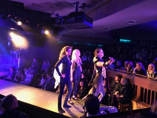 ACW Founder + Co-director Gina Murdock leads the Love Ninjas down the runway