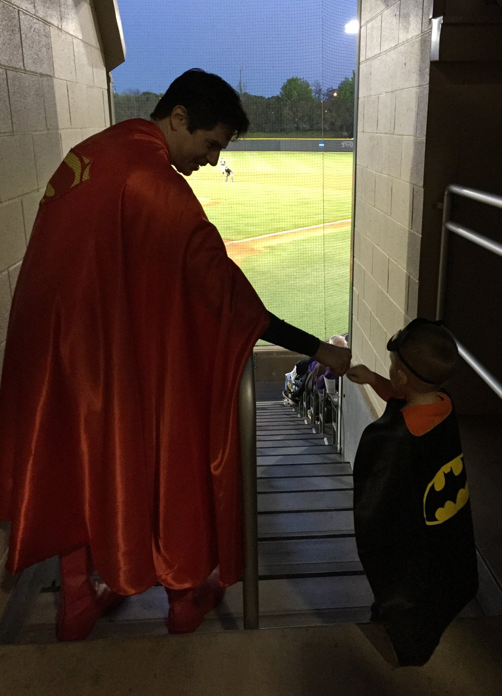 Superman shares a fist bump with the Caped Crusader.